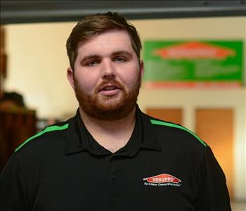 Man with brown hair in SERVPRO uniform