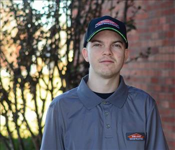 Man wearing SERVPRO hat and shirt
