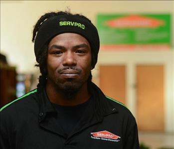Smiling young man in SERVPRO uniform