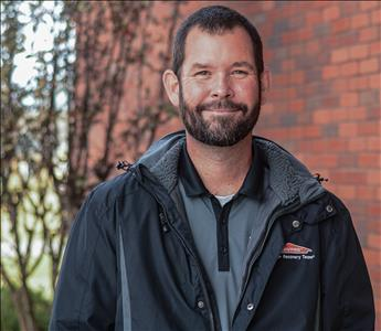 Man smiling in black SERVPRO jacket